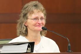 Deb on witness stand